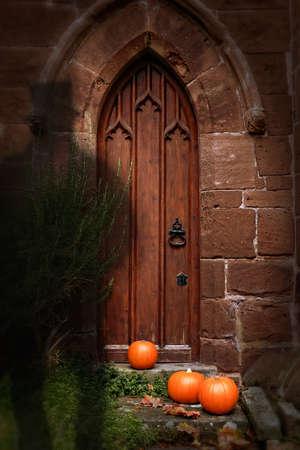 cemetry: Church door at Halloween with ghost wearing top hat