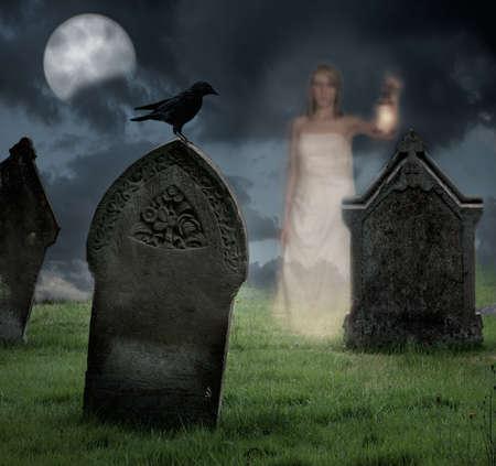 Woman holding lantern haunts cemetery at Halloween photo