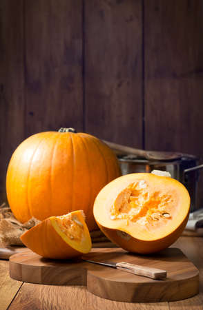 pumpkin seed: Slicing pumpkins for soup on Halloween Night
