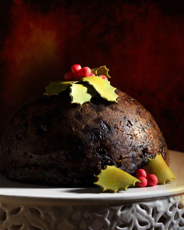 Christmas pudding decorated with holly and berries crafted from icing photo
