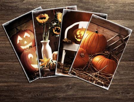 Vintage Halloween postcards on a wooden background photo