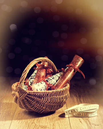 Homemade Christmas crackers in basket with vintage feel and bokeh background Stock Photo - 22079457