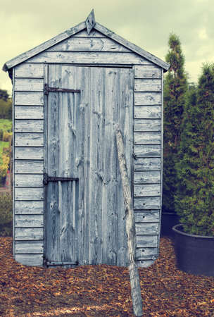 allotment: Garden shed in autumn with fallen leaves Stock Photo