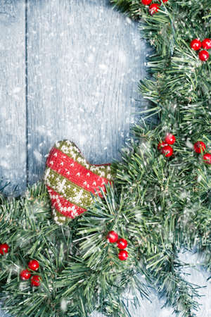 Winter Christmas wreath with falling snow photo