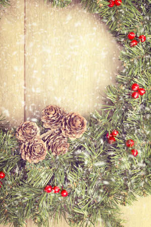 Christmas garland hanging from wooden door with falling snow photo