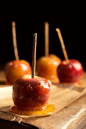 Close up of toffee apples on rustic board photo