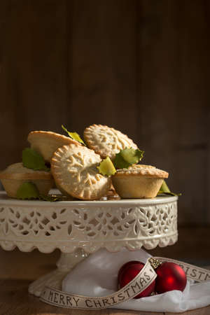 Festive homemade mince pies for Christmas on cake stand photo