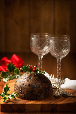christmas pudding: Christmas pudding with holly and berries Stock Photo