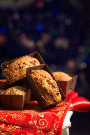wood chip: Banana and chocolate chip muffins in front of the Christmas tree