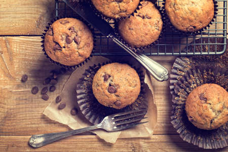 wood chip: Chocolate chip muffins on cooling rack