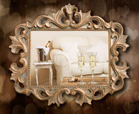 Champagne for two in antique gilt frame hanging on wall photo