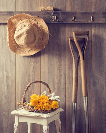 Rustic country shed interior with freshly picked yellow roses in basket photo