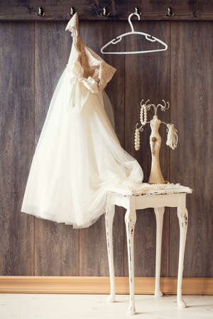 Pretty dress and table with pearl jewellery - vintage tone effect photo