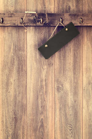 wood panelled: Clean slate sign with chalk hanging on wall - vintage tone effect applied to wood Stock Photo