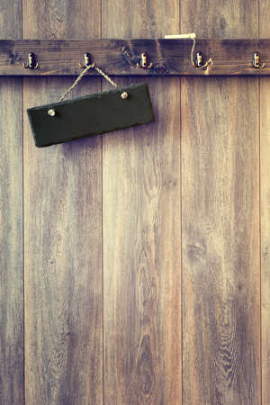 wood panelled: Blank slate sign hanging on rustic wooden wall - vintage tone effect added to wood