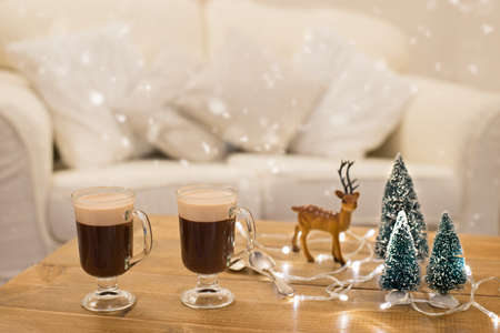 irish christmas: Winter Christmas coffees on table decorated with trees and reindeer