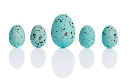 upright row: Row of blue speckled Easter eggs with drop shadow