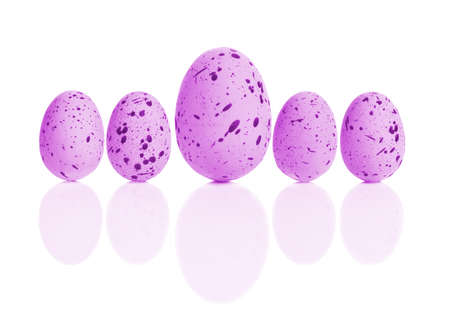 upright row: Brightly colored pink Easter eggs in a line Stock Photo