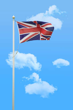 union jack flag: Union jack flying in the wind against blue summer sky