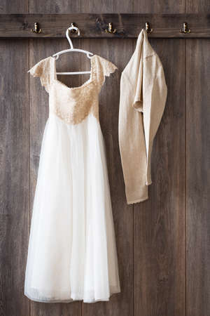 coathanger: Bridesmaid dress and cardigan hanging from hooks