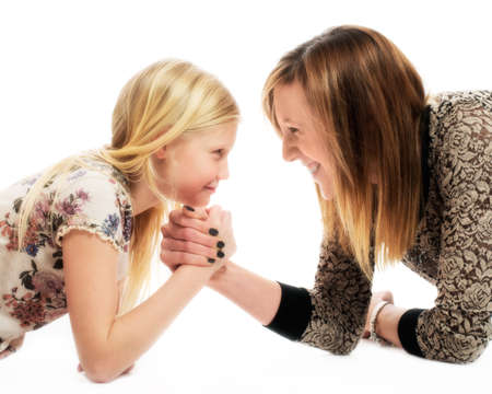 wrestle: Mother and daughter in playful arm wrestle