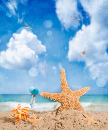 Starfish on the beach with windmill and textured overlay photo
