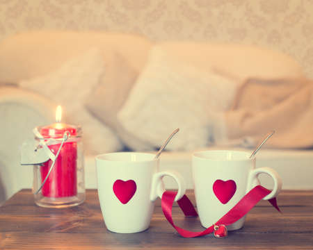 added: Two teacups with heart decoration - vintage effect added