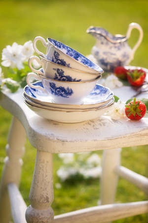 Antique blue and white cups and saucers for afternoon tea photo