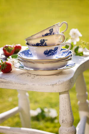 Pretty antique blue and white china in the garden for afternoon tea photo