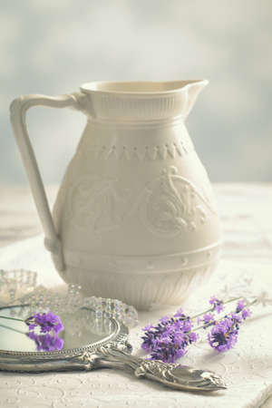 feminine hands: Antique silver mirror with lavender - vintage tone effect added