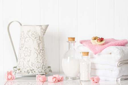 fluffy: Spa setting with fluffy white towels and pamper items