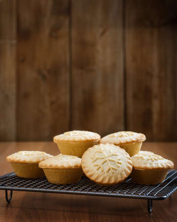 country kitchen: Mince pies on a cooling rack in country kitchen