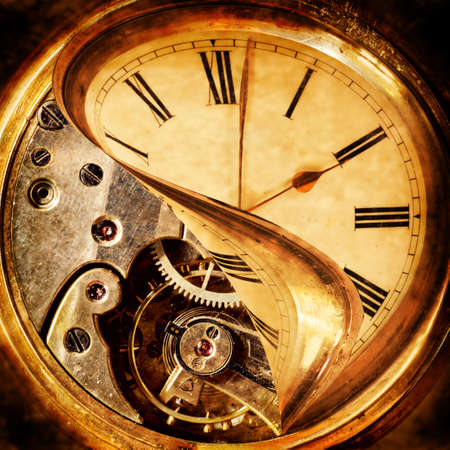 turn back: Face of an antique pocket watch being peeled back to reveal the cogs beneath