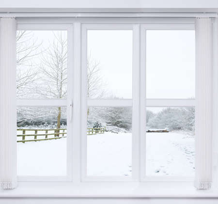 Modern window with snow scene outside Banque d'images