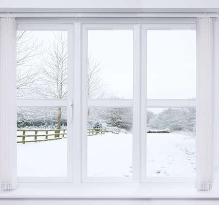 Modern window with snow scene outside photo