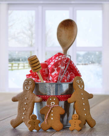 Freshly baked gingerbread cookies with baking utensils for Christmas photo