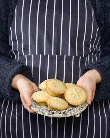 fayre: Freshly baked mince pies being held on a tray Stock Photo