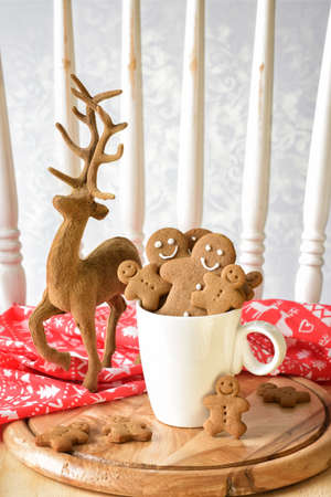 Gingerbread biscuits with reindeer ornament at Christmas photo
