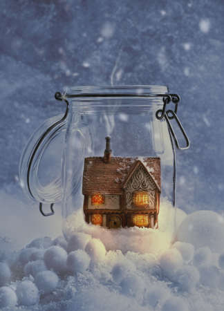 Cosy country cottage in snow filled glass jar at night