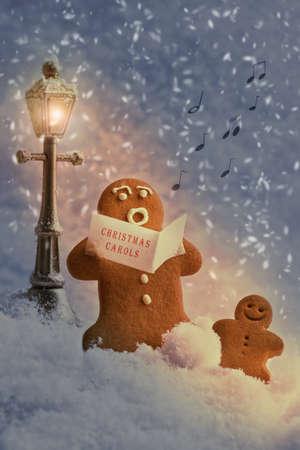 carols: Gingerbread men carol singers at Christmas
