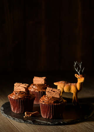 Display of chocolate cupcakes with reindeer decoration for Christmas photo