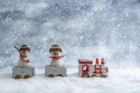 Funny snowmen in train photo