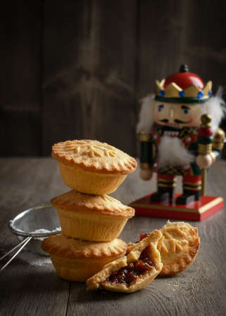 mince pie: Festive mince pie stack with Christmas decoration Stock Photo