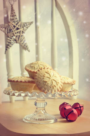 Mince pies on glass cake stand
