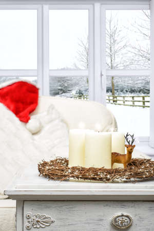 winter window: Christmas candles with winter snow scene window Stock Photo