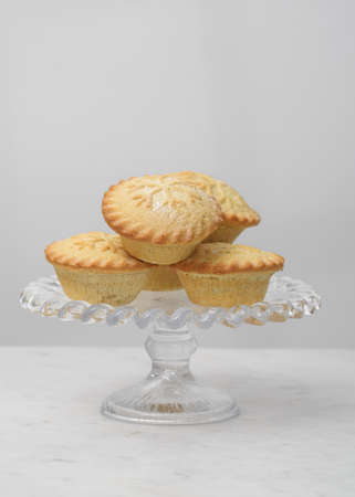 Mince pies on a glass stand
