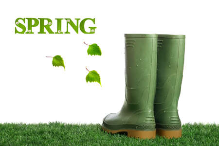 wellies: Dirty wellington boots with water droplets on artificial grass