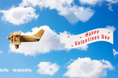 Vintage toy plane pulling a Valentines Day banner photo