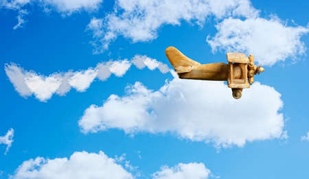 Toy plane in bright blue sky photo