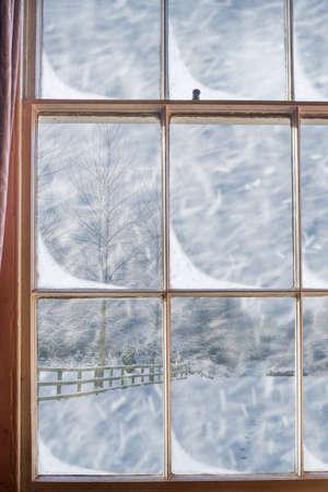 window pane: Old Georgian sash window overlooking snowy scene Stock Photo